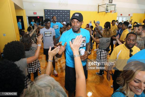 Udonis Haslem of the Miami Heat high fives fans during the Miami Heat Family Festival on March 3 2019 at American Airlines Arena in Miami Florida...