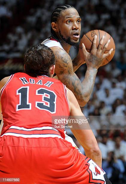 Udonis Haslem of the Miami Heat is covered by Joakim Noah of the Chicago Bulls in the second quarter during Game 3 of the NBA Eastern Conference...