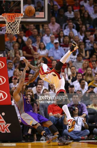 Udonis Haslem of the Miami Heat is fouled by PJ Tucker of the Phoenix Suns during a game at AmericanAirlines Arena on November 5 2012 in Miami Florida