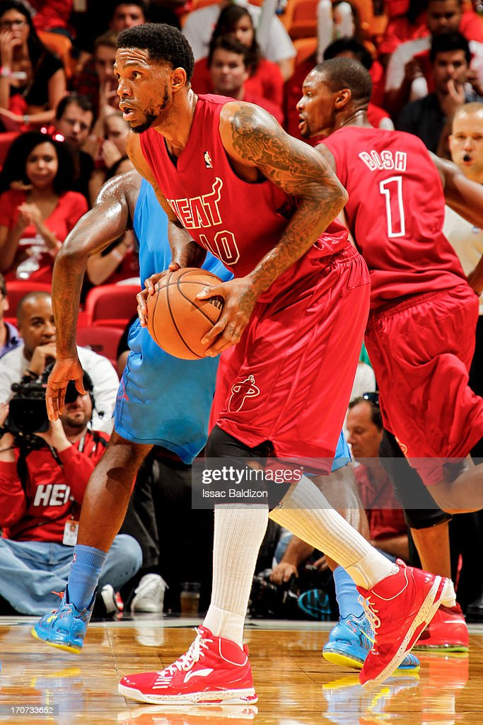 Udonis Haslem #40 of the Miami Heat looks to pass the ball against the Oklahoma City Thunder during a Christmas Day game on December 25, 2012 at American Airlines Arena in Miami, Florida.
