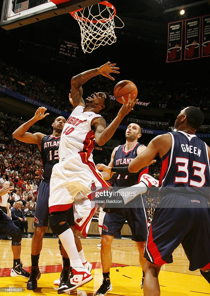Udonis Haslem #40 of the Miami Heat pulls down a rebound during the fourth quarter against the Atlanta Hawks on January 2, 2012 at American Airlines Arena in Miami, Florida.