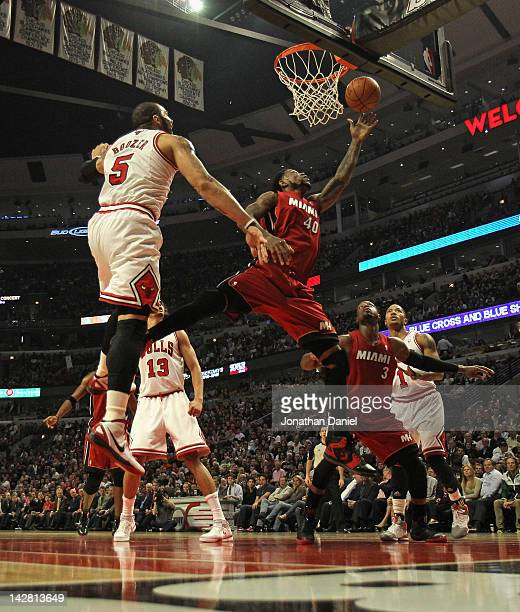 Udonis Haslem of the Miami Heat puts up a shot past Carlos Boozer of the Chicago Bulls at the United Center on April 12 2012 in Chicago Illinois NOTE...