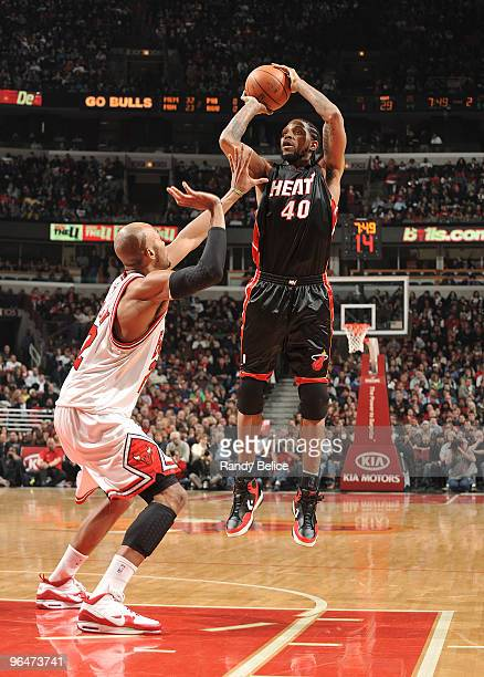 Udonis Haslem of the Miami Heat shoots a jumper over Taj Gibson of the Chicago Bulls during the NBA game on February 6 2010 at the United Center in...
