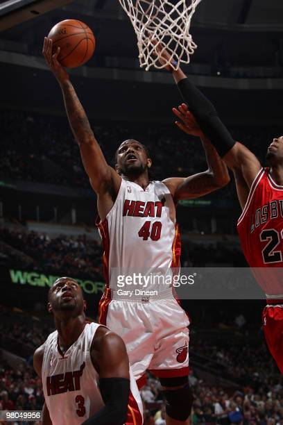Udonis Haslem of the Miami Heat shoots a layup against Taj Gibson of the Chicago Bulls on March 25 2010 at the United Center in Chicago Illinois NOTE...