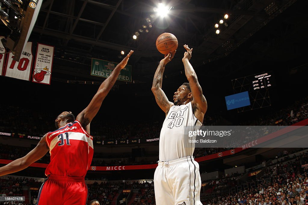 Udonis Haslem #40 of the Miami Heat shoots the ball over Chris Singleton #31 of the Washington Wizards during a game between the Washington Wizards and the Miami Heat on December 15, 2012 at American Airlines Arena in Miami, Florida.
