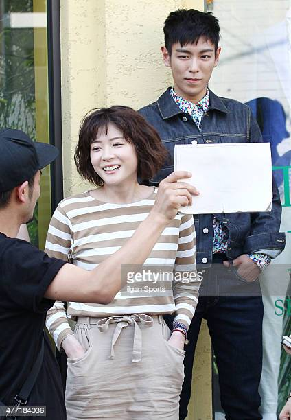 Ueno Juri and Top of Bigbang are seen during drama filiming at Samcheongdong on June 10 2015 in Seoul South Korea
