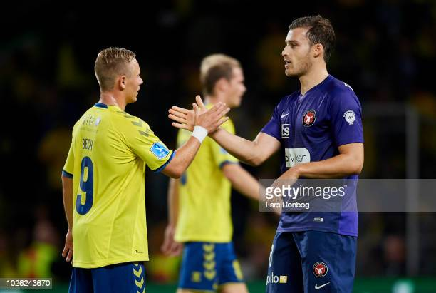 Uffe Bech of Brondby IF and Erik Sviatchenko of FC Midtjylland shake hands after the Danish Superliga match between Brondby IF and FC Midtjylland at...