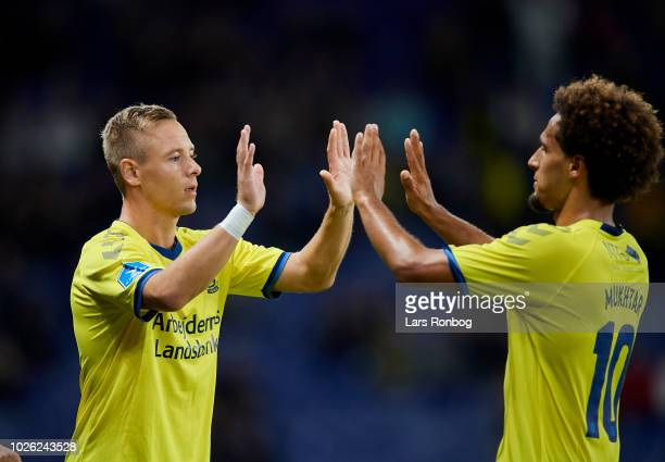 Uffe Bech of Brondby IF and Hany Mukhtar of Brondby IF shake hands during the Danish Superliga match between Brondby IF and FC Midtjylland at Brondby...