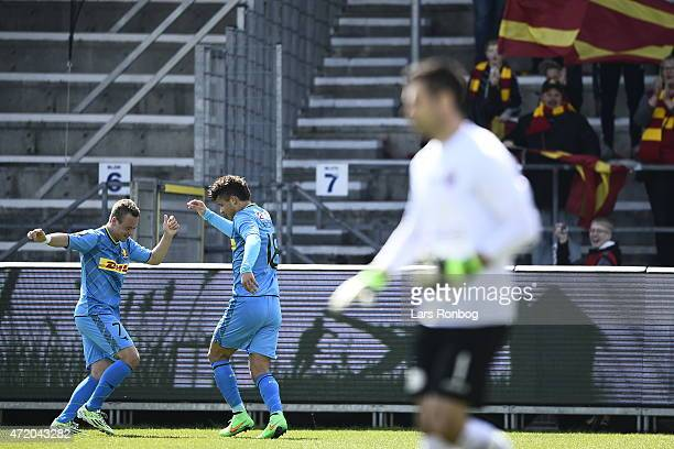 Uffe Bech of FC Nordsjalland and team mate Emiliano Marcondes celebrate after scoring their first goal during the Danish Alka Superliga match between...