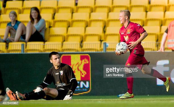 Uffe Bech of FC Nordsjalland celebrates after scoring their first goal watched by Goalkeeper Thomas Mikkelsen of FC Vastsjalland during the Danish...