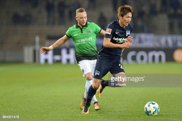 Uffe Bech of Hannover and Genki Haraguchi of Hertha battle for the ball during the HHotelscom Wintercup match between Hertha BSC and Hannover 96 at...