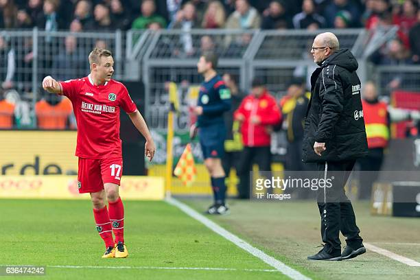 Uffe Manich Bech of Hannover 96 and Coach Thomas Schaaf of Hannover 96 looks on during the Bundesliga match between Borussia Dortmund and Hannover 96...