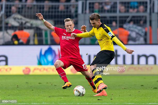 Uffe Manich Bech of Hannover 96 and Lukasz Piszczek of Bosussia Dortmund battle for the ball during the Bundesliga match between Borussia Dortmund...