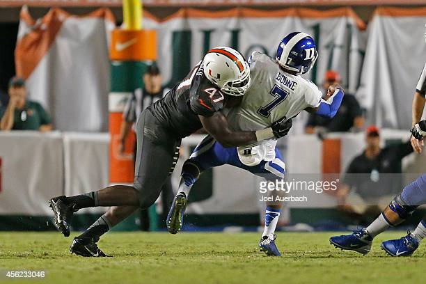 Ufomba Kamalu of the Miami Hurricanes sacks Anthony Boone of the Duke Blue Devils in fourth quarter action on September 27 2014 at Sun Life Stadium...