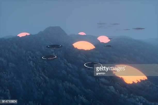 ufos flying over alien landscape - formação rochosa imagens e fotografias de stock