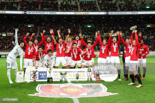 Ugajin Tomoya of Urawa Red Diamonds leads the players of Urawa Red Diamonds as they celebrate becoming champions after the 98th Emperor's Cup Final...