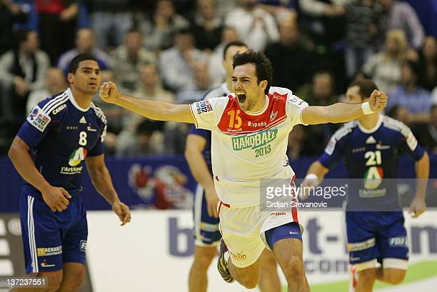 Ugalde Cristian of Spain celebrates after Spain beat France during the Men's European Handball Championship 2012 group C match between France and...