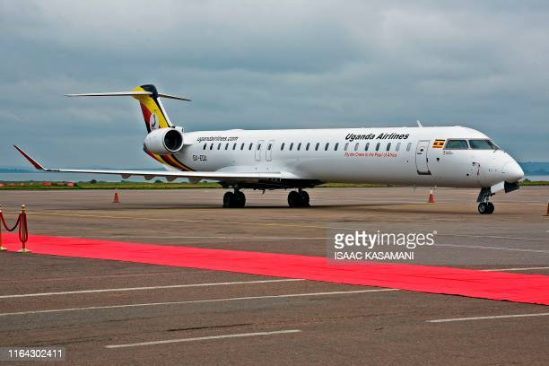 A Uganda Airlines Bombadier aircraft prepares for departure at Entebbe airport during the launch of Uganda Airlines maiden flight to Jomo Kenyatta...