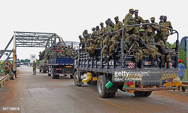 Uganda military personnel are seen atop military and police trucks as they drive towards Juba in South Sudan at Nimule border point on July 14 2016...