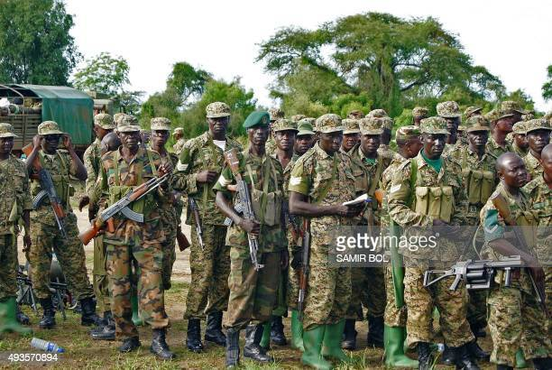 Uganda People's Defence Force troops assemble amongst their vehicles in Bor on October 20, 2015. The South Sudanese military leadership has announced...