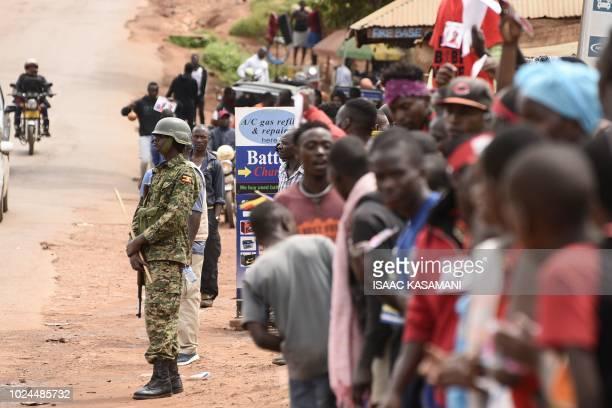 A Uganda People's Defence Forces soldier maintains post as supporters of detained Ugandan singerturnedpolitician Robert Kyagulanyi aka Bobi Wine...