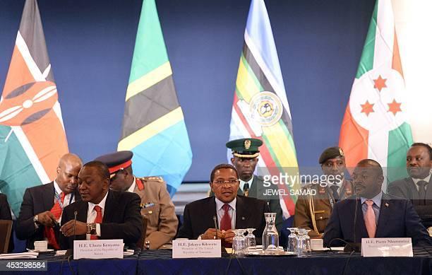 Uganda President Yoweri Museveni Kenya President Uhuru Kenyatta and Tanzania President Jakaya Kikwete attend in a roundtable discussion with American...