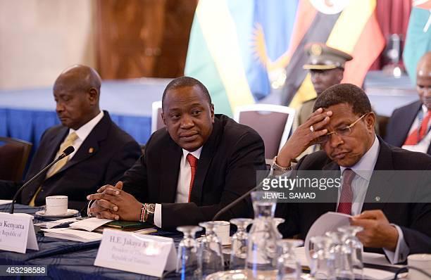 Uganda President Yoweri Museveni Kenya President Uhuru Kenyatta and Tanzania President Jakaya Kikwete attend a roundtable discussion with American...