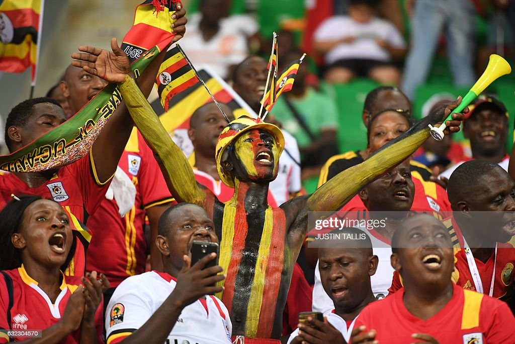 Uganda supporters cheer ahead of the 2017 Africa Cup of Nations group D football match between Egypt and Uganda in Port-Gentil on January 21, 2017. / AFP / Justin TALLIS