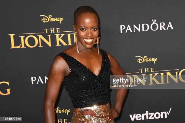 "Ugandan actress Florence Kasumba arrives for the world premiere of Disney's ""The Lion King"" at the Dolby theatre on July 9, 2019 in Hollywood."