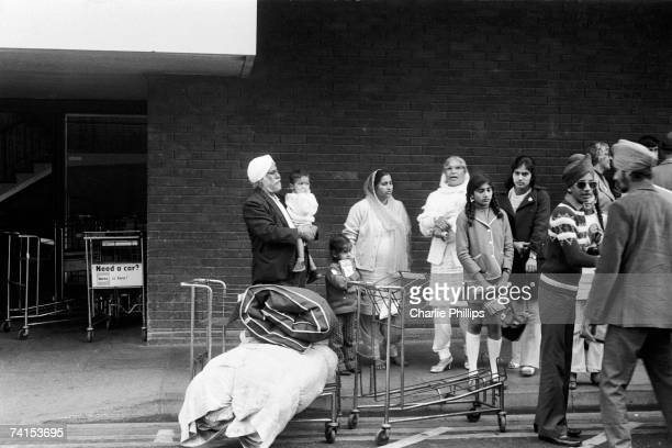 Ugandan Asian refugees arrive at Heathrow Airport after their expulsion from Uganda under the regime of Idi Amin, 1972.