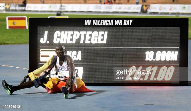 Ugandan athlete Joshua Cheptegei celebrates after breaking the 10,000m track world record during the NN Valencia World Record Day at the Turia...