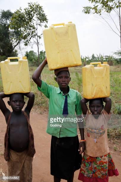 Ugandan children fetching water Uganda