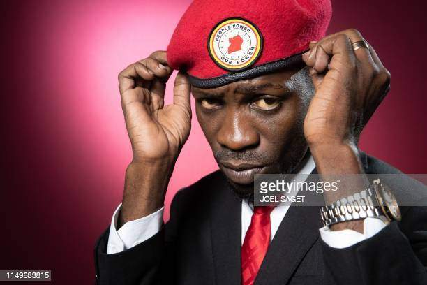 Ugandan former musician and Uganda's political opposition figurehead Hon Kagulanyi Robert also known with his stage name Bobi Wine poses during a...