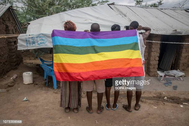 Ugandan LGBT refugees pose in a protected section of Kakuma refugee camp in northwest Kenya They fled Uganda following the antigay law brought in...
