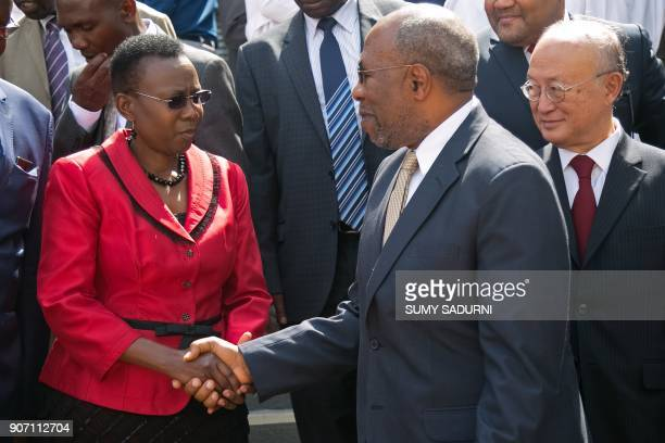 Ugandan minister of health Jane Aceng shakes hands with Prime Minister of Uganda Ruhakana Rugunda during the ceremony of the official commissioning...