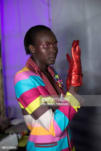 Ugandan model Patricia Akello waits backstage before a show with the South African designers KLuk CGDT on August 16 2017 in Mall of Africa north of...