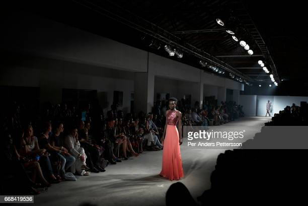 Ugandan model Sharon Murembe walks during a fashion show at Kampala Fashion Week on the rooftop of the Acacia Mall Kampala Uganda on November 11 2015