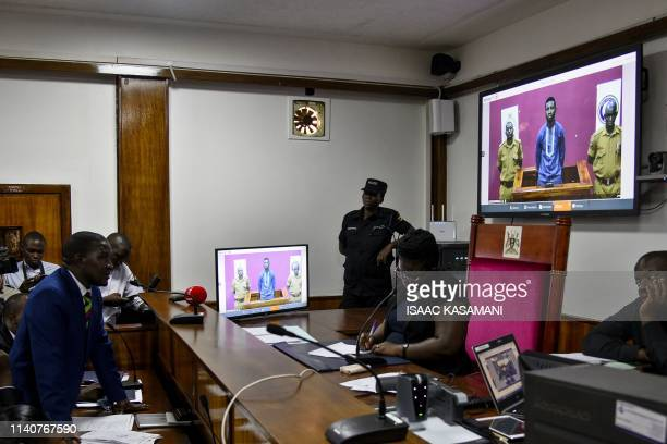 Ugandan musician turned politician Robert Kyagulanyi aka Bobi Wine attends court via video link in Kampala on May 2 which released him on bail for...