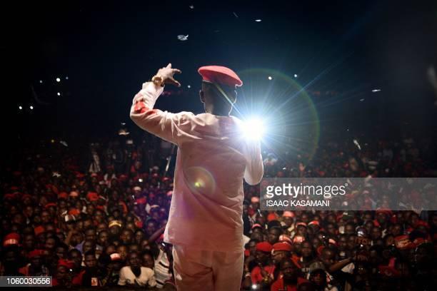 TOPSHOT Ugandan musician turned politician Robert Kyagulanyi commonly known as Bobi Wine sings on a stage in Busabala suburb of Kampala Uganda on...