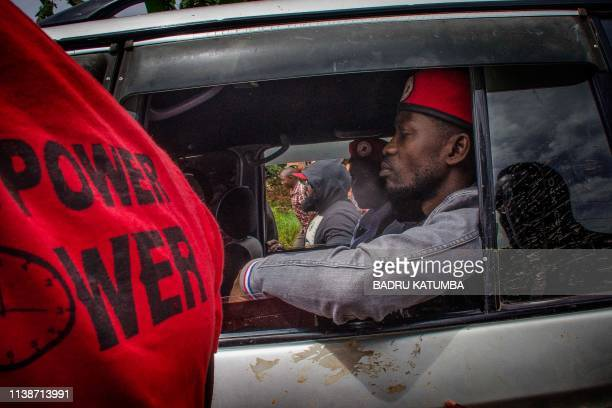 Ugandan musician turned politician Robert Kyagulanyi commonly known as Bobi Wine sits in his car before his arrest on his way to a press conference...