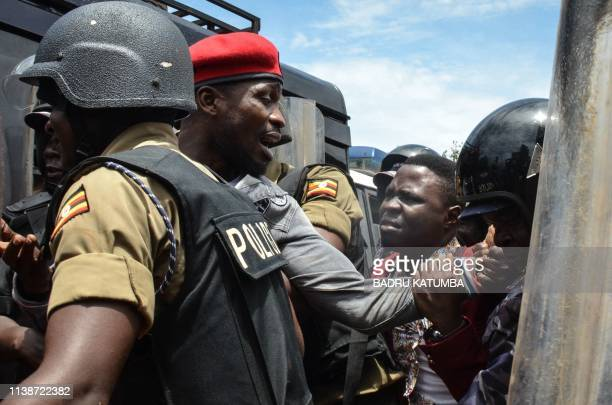 Ugandan musician turned politician Robert Kyagulanyi commonly known as Bobi Wine is arrested by police on his way to a press conference held to...