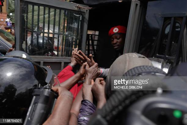 TOPSHOT Ugandan musician turned politician Robert Kyagulanyi commonly known as Bobi Wine is arrested by police on his way to a press conference held...