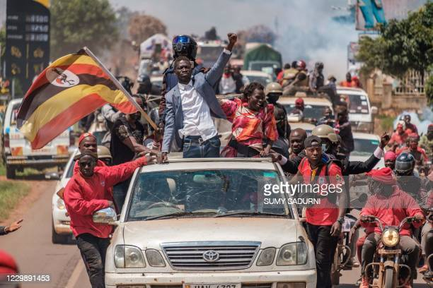 Ugandan musician-turned-politician Robert Kyagulanyi, also known as Bobi Wine , greets supporters as he sets off on his campaign trail towards...