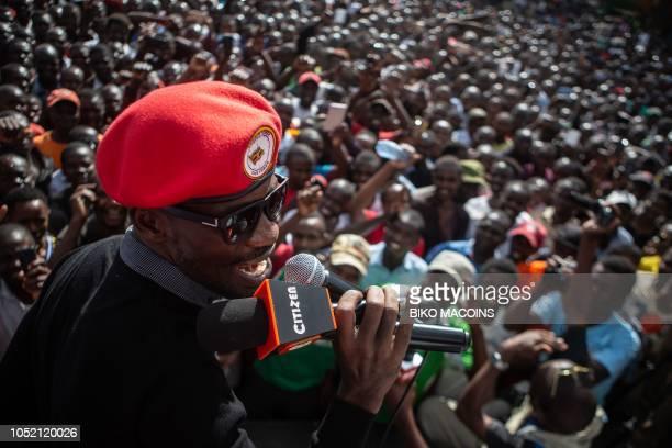 Ugandan politician Robert Kyagulanyi better known as pop star Bobi Wine speaks to people at Kibera slum in Nairobi on October 14 2018 during...