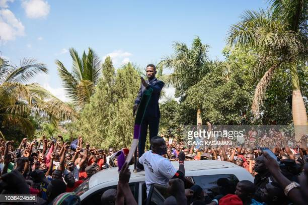 TOPSHOT Ugandan pop star turned opposition MP Robert Kyagulanyi delivers a speech outside his home in Kampala Uganda after returning from the United...