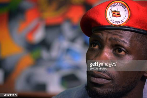 Ugandan pop star turned opposition MP Robert Kyagulanyi popularly known by pop name Bobi Wine listens to presentation at the PAWA 254 offices in...
