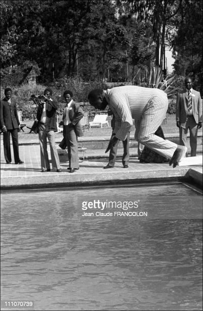 Ugandan president Idi Amin Dada diving in the swimming pool in the summit of Uganda in Addis Ababa Ethiopia on January 10 1976