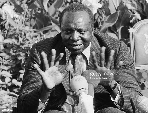 Ugandan President Idi Amin gestures during a speech in 1973
