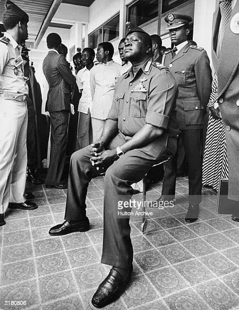 Ugandan President Idi Amin resting on a shooting stick while attending the Organization for African Unity summit in Libreville circa 1971 He told...