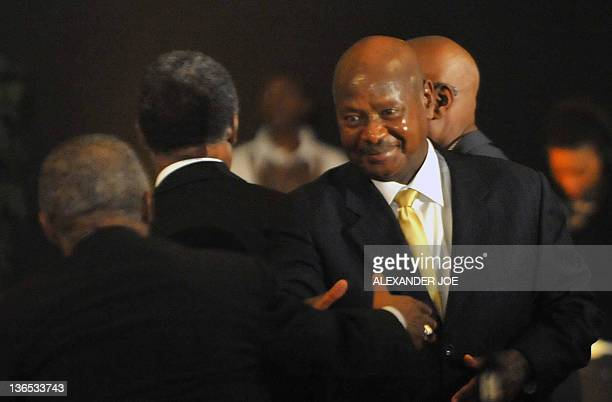 Ugandan President Yoweri Museven greets Zambia's President Michael Sata at a Gala Dinner in Bloemfontein on January 7 2012 South Africa's mighty...